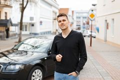 Free Handsome Young Businessman Man Near A Black Car On The Street. Royalty Free Stock Photography - 124242527