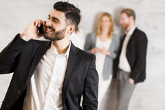 Handsome young businessman with mobile phone Stock Photo