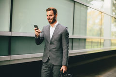 Handsome young businessman with mobile phone Royalty Free Stock Photo