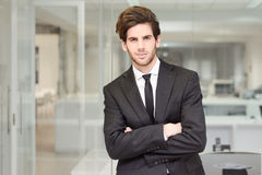 Handsome young businessman in an office Stock Image