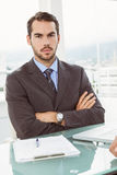 Handsome young businessman at office desk Stock Image