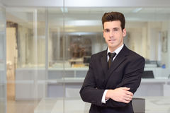 Handsome young businessman in an office Stock Photos