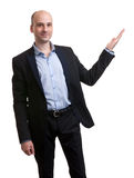 Handsome young businessman pointing to something Royalty Free Stock Photo