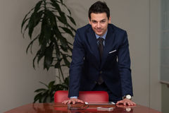 Handsome Young Businessman Portrait In His Office Royalty Free Stock Image