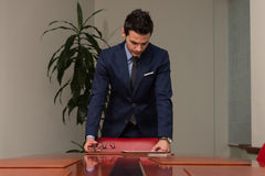 Handsome Young Businessman Portrait In His Office Stock Photos