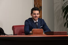 Handsome Young Businessman Portrait In His Office Royalty Free Stock Photography
