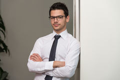 Handsome Young Businessman Portrait In His Office Stock Images