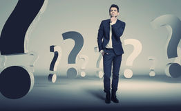 Handsome young businessman about question Stock Photography