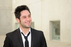 Handsome young businessman smiling Royalty Free Stock Image
