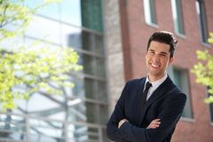 Handsome young businessman smiling outdoors Stock Photography