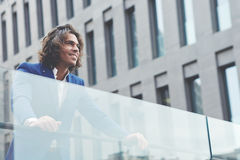 Handsome young businessman standing in the city looking happy and satisfied Stock Photo
