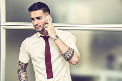 Handsome young businessman talking on cell phone Royalty Free Stock Photography