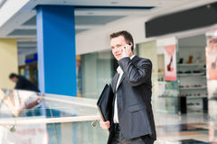 Handsome young businessman talking on his mobile Royalty Free Stock Photo