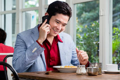 Handsome young businessman talking on a mobile Stock Photos