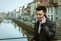 Handsome young businessman talking on phone Royalty Free Stock Images