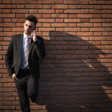 Handsome young businessman talking on phone Royalty Free Stock Photography