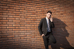 Handsome young businessman talking on phone Royalty Free Stock Photos