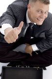 Handsome young businessman with thumbs up Stock Image