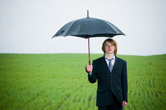 Handsome young businessman with umbrella Royalty Free Stock Image