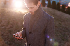 A handsome young businessman using his phone Royalty Free Stock Photography