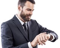 Handsome young businessman using smart watch. Stock Images