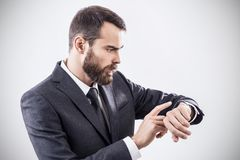 Handsome young businessman using smart watch. Royalty Free Stock Images