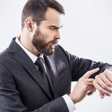 Handsome young businessman using smart watch. Royalty Free Stock Image