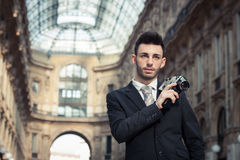 Handsome young businessman using a vintage film camera Royalty Free Stock Photos