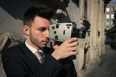 Handsome young businessman using a vintage film camera Stock Photo