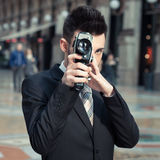 Handsome young businessman using a vintage film camera Royalty Free Stock Photo