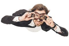 handsome young businessman in vintage aviation goggles falling royalty free stock photo