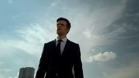 Handsome young businessman walking outdoor success and self-confidence concept royalty free stock image