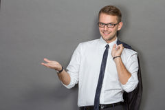 A handsome young businessman wearing glasses and smiling. Vertic Royalty Free Stock Image