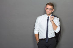 A handsome young businessman wearing glasses. Vertical shot. Royalty Free Stock Photo