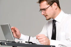 Handsome young businessman working stock photo