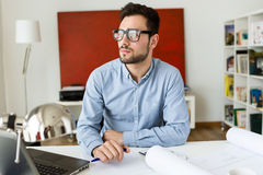 Handsome young businessman working in the office. Stock Photos