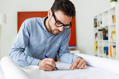 Handsome young businessman working in the office. Stock Photo