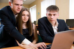 Handsome young businessmen working on laptop Stock Photography