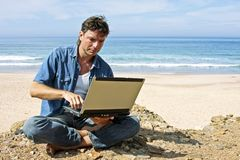 Handsome young bussiness guy working on the intern Stock Photography
