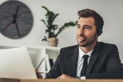 Handsome young call center worker talking. By mike Royalty Free Stock Images