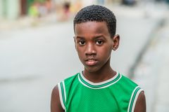 Handsome young caribbean boy. Portrait of a young black child.. royalty free stock photo