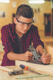 Handsome young carpenter Stock Image