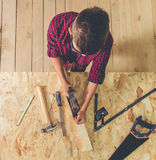 Handsome young carpenter Stock Images