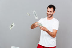 Handsome young casual man counting money Stock Photo