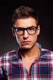 Handsome young casual man looking into the camera Royalty Free Stock Images