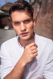Handsome young casual man looking at the camera. Royalty Free Stock Photos