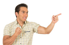 Handsome young casual man posing pointing to the Stock Images