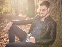 Handsome young casual man sitting in the park, Royalty Free Stock Photos