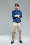 Handsome young casual man standing with hands crossed Royalty Free Stock Photo