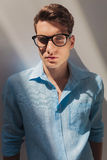 Handsome young casual man wearing a blue shirt Stock Photos